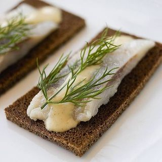 Herring with mustard and dill on a rye bread